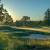 A sunset view of a hole at Knob Hill Golf Course.
