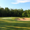 A sunny day view from a fairway at Sandstone Hollow Golf Club from Turning Stone.