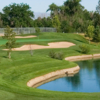 A sunny day view of a hole at Los Lagos Golf Course.