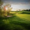 A sunny day view of a green at Legacy Golf Club.