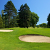 A sunny day view of a well protected hole at West Seattle Golf Club.