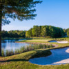 A sunny day view of a hole at Woodlands Club.