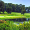A view over the water of a hole at Huntingdon Valley Country Club.