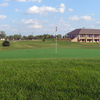 A view of the 1st green with clubhouse in background at Little Bear Golf Club
