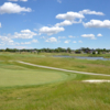 A sunny day view of a hole at Seven Lakes Golf Course.