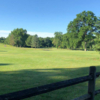 A sunny day view of a hole at Rockleigh Golf Course.