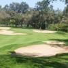 A sunny day view of a green at Dar Es Salam Royal Golf Club.
