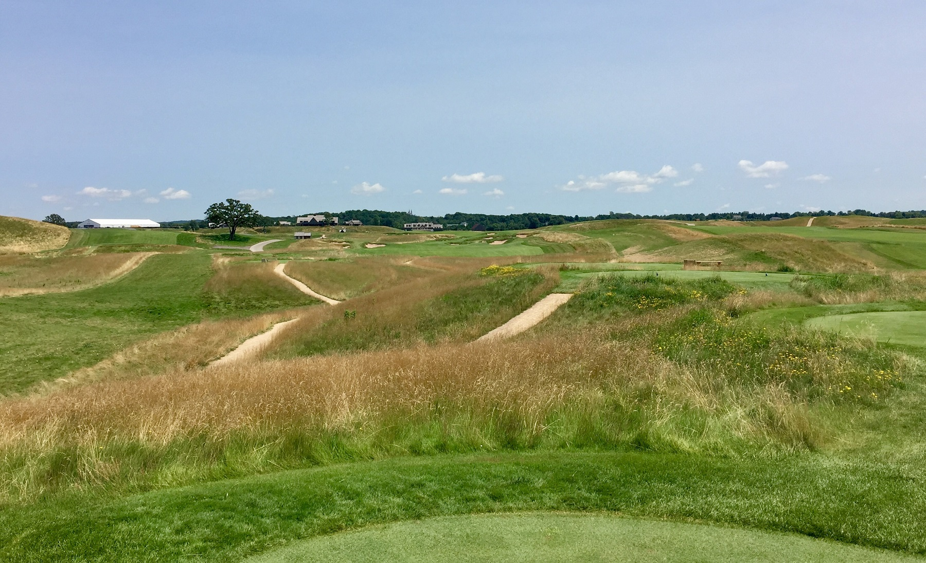 No one's denying the awesomeness of a 379-yard three-wood, but there's also no denying the 18th tee at Erin Hills is a launchpad of sorts.