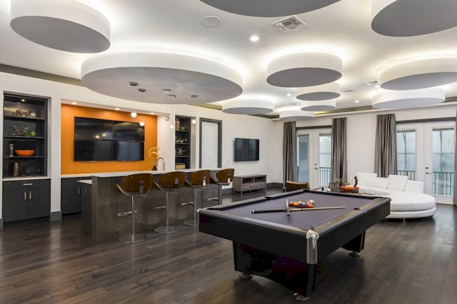 This 9-bedroom house at Reunion Resort in Orlando has an amazing billiards/hangout room.